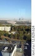 Купить «Вид с высоты на Лужники», фото № 12829624, снято 26 сентября 2015 г. (c) Дмитрий Никитин / Фотобанк Лори