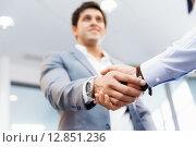 Купить «Handshake of businessmenoncepts - soft focus», фото № 12851236, снято 25 января 2015 г. (c) Sergey Nivens / Фотобанк Лори