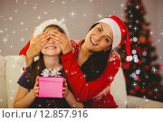Купить «Composite image of mother surprising her daughter with christmas gift», фото № 12857916, снято 16 декабря 2018 г. (c) Wavebreak Media / Фотобанк Лори
