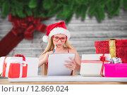 Купить «Composite image of festive blonde writing her christmas list», фото № 12869024, снято 16 сентября 2019 г. (c) Wavebreak Media / Фотобанк Лори