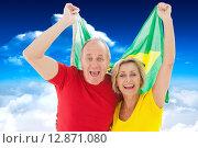 Купить «Composite image of happy older couple cheering at camera holding brazil flag», фото № 12871080, снято 20 января 2019 г. (c) Wavebreak Media / Фотобанк Лори