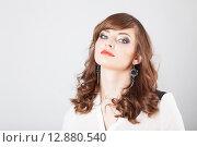 Купить «Портрет красивой девушки с серьгами», фото № 12880540, снято 19 ноября 2018 г. (c) Efanov Aleksey / Фотобанк Лори