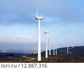 Купить «Wind farm at mountains», фото № 12887316, снято 26 апреля 2018 г. (c) Яков Филимонов / Фотобанк Лори