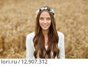 Купить «smiling young hippie woman on cereal field», фото № 12907312, снято 27 августа 2015 г. (c) Syda Productions / Фотобанк Лори