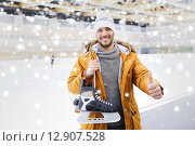 Купить «happy young man showing thumbs up on skating rink», фото № 12907528, снято 26 ноября 2014 г. (c) Syda Productions / Фотобанк Лори