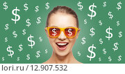 Купить «happy woman in shades with dollar currency sings», фото № 12907532, снято 22 апреля 2019 г. (c) Syda Productions / Фотобанк Лори