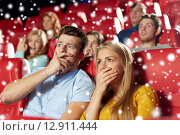 Купить «friends or couple watching horror movie in theater», фото № 12911444, снято 19 января 2015 г. (c) Syda Productions / Фотобанк Лори