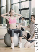 Купить «smiling man and woman with exercise ball in gym», фото № 12912044, снято 29 июня 2014 г. (c) Syda Productions / Фотобанк Лори