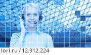 Купить «helpline operator in headset over blue grid», фото № 12912224, снято 15 апреля 2014 г. (c) Syda Productions / Фотобанк Лори