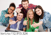 Купить «group of happy students showing thumbs up», фото № 12913324, снято 16 июня 2013 г. (c) Syda Productions / Фотобанк Лори