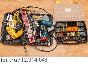 Купить «Tool box and set of screws», фото № 12914048, снято 31 августа 2015 г. (c) Ярочкин Сергей / Фотобанк Лори