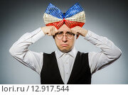 Купить «Funny man with giant bow tie», фото № 12917544, снято 24 февраля 2015 г. (c) Elnur / Фотобанк Лори