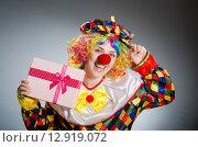 Купить «Funny clown in comical concept», фото № 12919072, снято 1 июля 2015 г. (c) Elnur / Фотобанк Лори