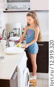 Купить «female child cleaning dishware at home», фото № 12919320, снято 29 января 2020 г. (c) Яков Филимонов / Фотобанк Лори