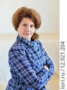Купить «Portrait of adult female on a light background», фото № 12921204, снято 21 октября 2015 г. (c) Володина Ольга / Фотобанк Лори