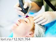 Купить «woman under laser cosmetology procedure», фото № 12921764, снято 13 апреля 2015 г. (c) Дмитрий Калиновский / Фотобанк Лори