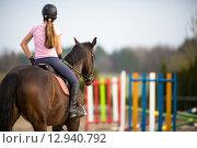 Купить «Young woman show jumping with horse», фото № 12940792, снято 19 февраля 2019 г. (c) PantherMedia / Фотобанк Лори