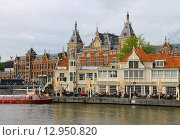 Купить «Вид на набережную напротив центрального вокзала в Амстердаме», фото № 12950820, снято 20 июня 2015 г. (c) Николай Кокарев / Фотобанк Лори