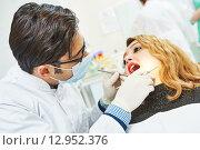 Купить «Young asian dentist doctor», фото № 12952376, снято 27 февраля 2015 г. (c) Дмитрий Калиновский / Фотобанк Лори