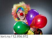 Купить «Funny clown in comical concept», фото № 12956972, снято 1 июля 2015 г. (c) Elnur / Фотобанк Лори