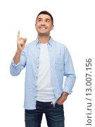 Купить «smiling man pointing finger up», фото № 13007156, снято 3 февраля 2015 г. (c) Syda Productions / Фотобанк Лори