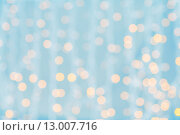 Купить «blurred background with bokeh lights», фото № 13007716, снято 10 сентября 2014 г. (c) Syda Productions / Фотобанк Лори