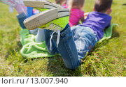Купить «close up of kids lying on picnic blanket outdoors», фото № 13007940, снято 13 июня 2015 г. (c) Syda Productions / Фотобанк Лори