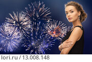 Купить «beautiful woman wearing earrings over firework», фото № 13008148, снято 17 марта 2013 г. (c) Syda Productions / Фотобанк Лори