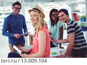 Купить «Creative businessteam working hard together», фото № 13009104, снято 5 июня 2015 г. (c) Wavebreak Media / Фотобанк Лори