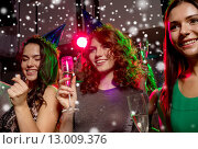 Купить «smiling friends with glasses of champagne in club», фото № 13009376, снято 20 октября 2014 г. (c) Syda Productions / Фотобанк Лори