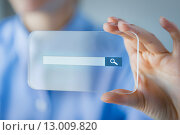 Купить «close up of woman with transparent smartphone», фото № 13009820, снято 13 августа 2015 г. (c) Syda Productions / Фотобанк Лори