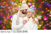 Купить «happy couple in winter clothes hugging over lights», фото № 13009844, снято 3 октября 2015 г. (c) Syda Productions / Фотобанк Лори