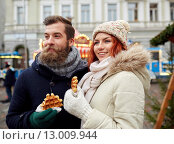 Купить «happy couple walking in old town», фото № 13009944, снято 11 декабря 2014 г. (c) Syda Productions / Фотобанк Лори
