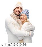 Купить «smiling couple in winter clothes hugging», фото № 13010544, снято 8 октября 2015 г. (c) Syda Productions / Фотобанк Лори