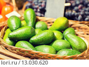 Купить «avocado in basket at food market», фото № 13030620, снято 20 декабря 2014 г. (c) Syda Productions / Фотобанк Лори