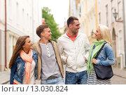 Купить «group of smiling friends walking in the city», фото № 13030824, снято 14 июня 2014 г. (c) Syda Productions / Фотобанк Лори