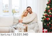 Купить «happy couple at home with christmas tree», фото № 13031940, снято 8 октября 2015 г. (c) Syda Productions / Фотобанк Лори