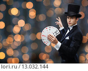 Купить «magician showing trick with playing cards», фото № 13032144, снято 12 сентября 2013 г. (c) Syda Productions / Фотобанк Лори