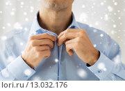 Купить «close up of man in shirt dressing», фото № 13032176, снято 13 ноября 2014 г. (c) Syda Productions / Фотобанк Лори