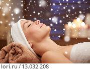Купить «close up of smiling young woman lying in spa salon», фото № 13032208, снято 18 декабря 2014 г. (c) Syda Productions / Фотобанк Лори