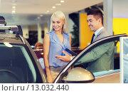 happy woman with car dealer in auto show or salon. Стоковое фото, фотограф Syda Productions / Фотобанк Лори
