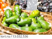 Купить «avocado in basket at food market», фото № 13032536, снято 20 декабря 2014 г. (c) Syda Productions / Фотобанк Лори