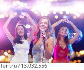 Купить «happy women singing karaoke and dancing», фото № 13032556, снято 20 октября 2013 г. (c) Syda Productions / Фотобанк Лори