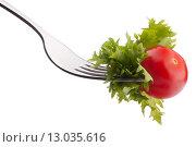 Fresh salad and cherry tomato on fork isolated on white background cutout. Стоковое фото, фотограф Natalja Stotika / Фотобанк Лори