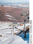 Купить «Ski lifts durings bright winter day», фото № 13038388, снято 27 февраля 2015 г. (c) Elnur / Фотобанк Лори