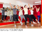 Купить «Males and females dancing», фото № 13047824, снято 25 марта 2019 г. (c) Яков Филимонов / Фотобанк Лори