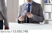 Купить «close up of businessman taking money bribe», видеоролик № 13050748, снято 12 апреля 2015 г. (c) Syda Productions / Фотобанк Лори
