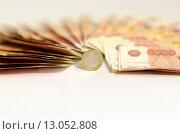 Купить «Монета один евро на фоне пятитысячных рублевых купюр», фото № 13052808, снято 13 ноября 2015 г. (c) Ивашков Александр / Фотобанк Лори