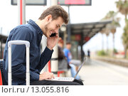 Купить «Freelancer working with a laptop and phone in a train station», фото № 13055816, снято 10 декабря 2017 г. (c) PantherMedia / Фотобанк Лори