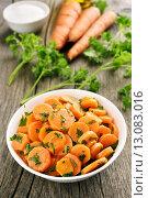 Купить «Салат из морковки на деревянном фоне», фото № 13083016, снято 21 октября 2015 г. (c) Татьяна Волгутова / Фотобанк Лори